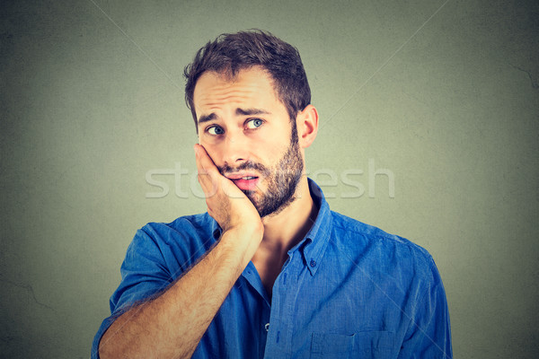 No motivation in life. Sad worried man isolated on gray wall background  Stock photo © ichiosea