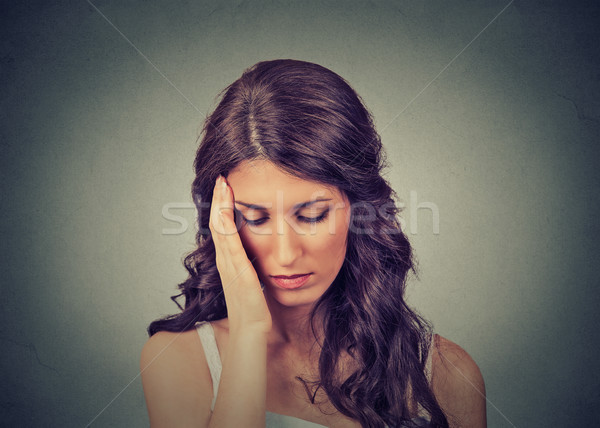 Sad woman with worried stressed face expression looking down depressed has no motivation in life  Stock photo © ichiosea