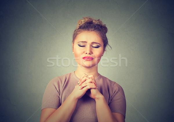 Closeup portrait of a young woman praying Stock photo © ichiosea