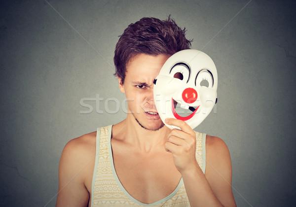 Zaklatott csalódott mérges férfi rejtőzködik mögött Stock fotó © ichiosea