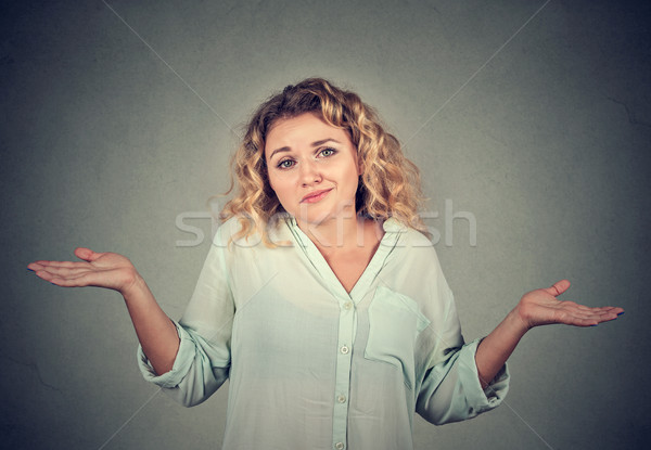 dumb looking woman arms out shrugs shoulders Stock photo © ichiosea