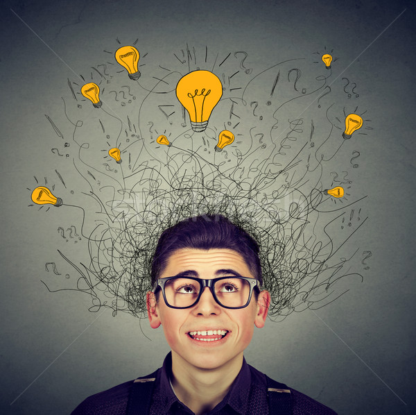 Brain connections. Man with many ideas light bulbs above head Stock photo © ichiosea