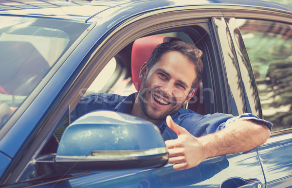 Man driver happy smiling showing thumbs up driving sport car Stock photo © ichiosea
