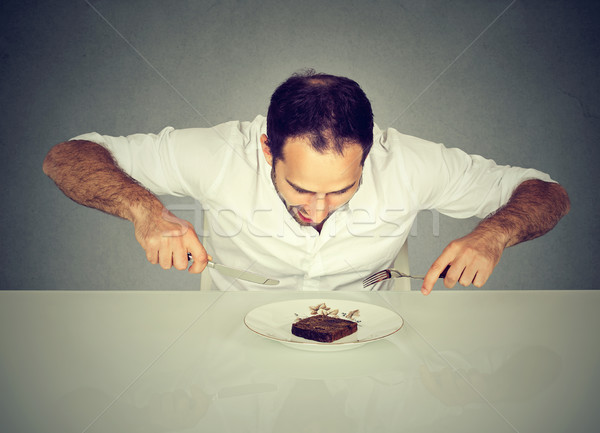 Hungry man craving sweet food pound cake  Stock photo © ichiosea