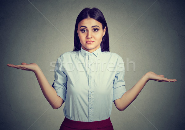 Woman with arms out shrugs shoulders so what I don't know Stock photo © ichiosea