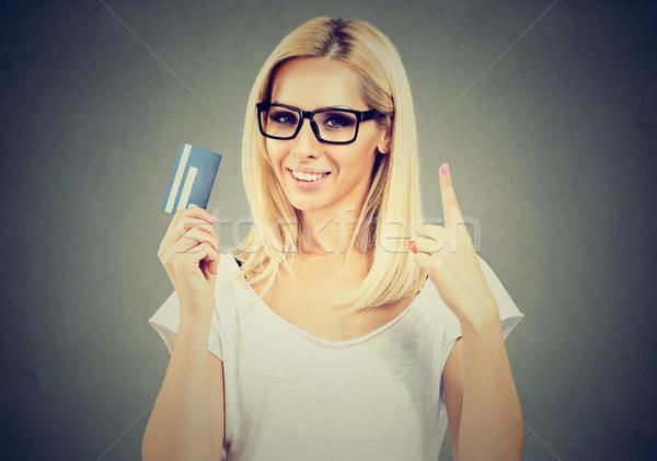Boldog nő visel szemüveg tart mutat Stock fotó © ichiosea