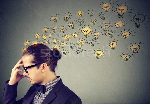 Férfi visel szemüveg sok ötletek gondolkodik Stock fotó © ichiosea
