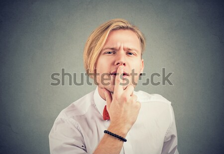 woman pinches nose with fingers something stinks Stock photo © ichiosea