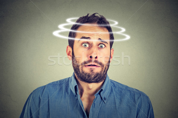 Head is spinning. Surprise astonished man Stock photo © ichiosea