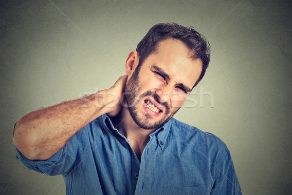 stressed, unhappy young handsome man with bad neck pain Stock photo © ichiosea