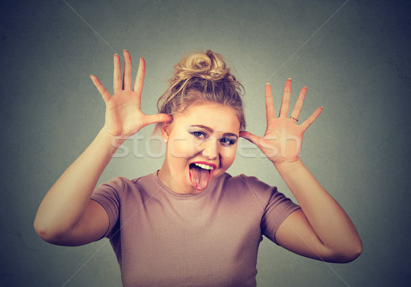 Jeune femme drôle de visage quelqu'un amusement Photo stock © ichiosea