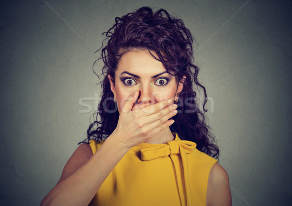 Scared woman with hand on mouth   Stock photo © ichiosea