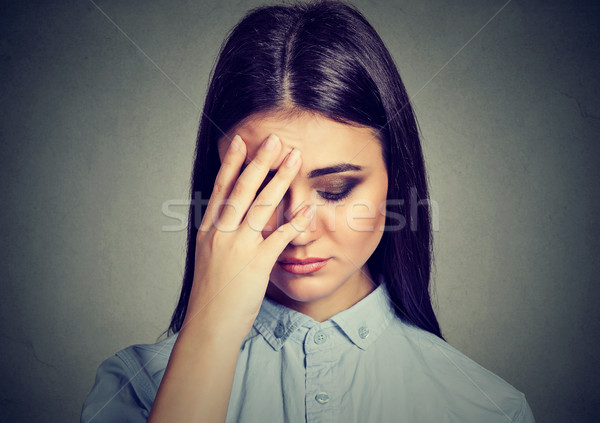 Closeup depressed sad woman looking down leaning head on hand  Stock photo © ichiosea