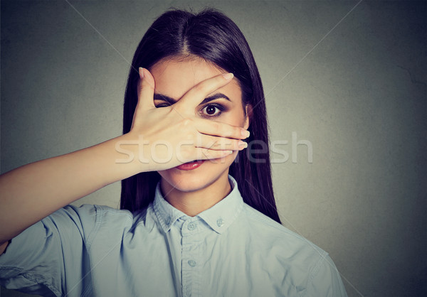 Happy woman peeping at you through fingers  Stock photo © ichiosea