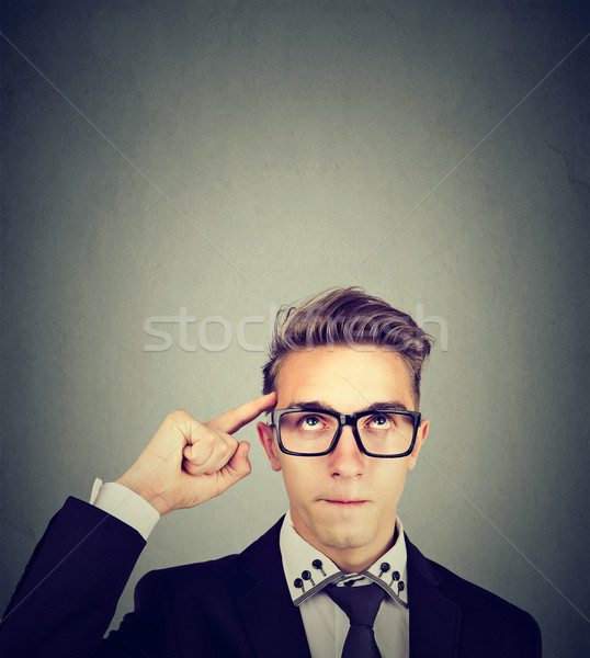nerdy man with glasses looking up Stock photo © ichiosea