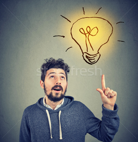 Okos hipszter férfi ötlet mutat felfelé Stock fotó © ichiosea
