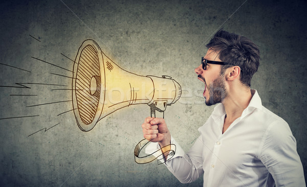 Man screaming into loud speaker Stock photo © ichiosea