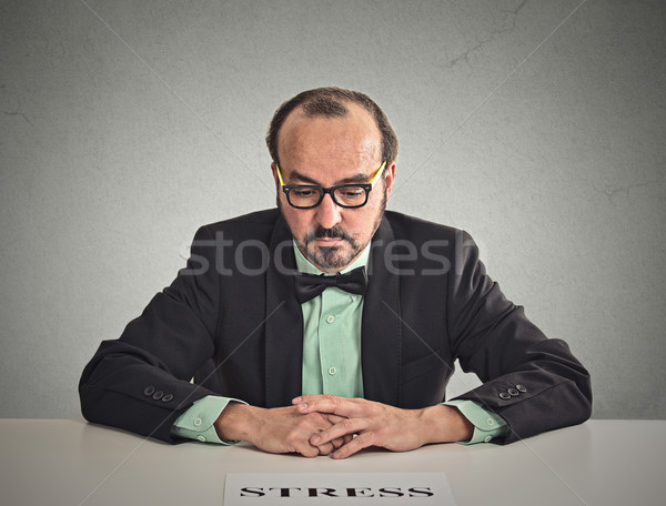 Sad stressed man sitting at office desk Stock photo © ichiosea