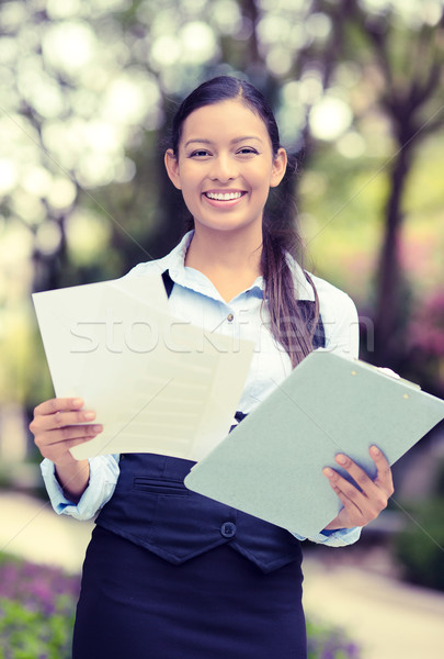happy young businesswoman standing reading, company documents Stock photo © ichiosea
