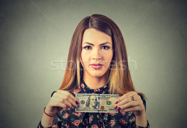 Rich young woman with one hundred dollar bill  Stock photo © ichiosea