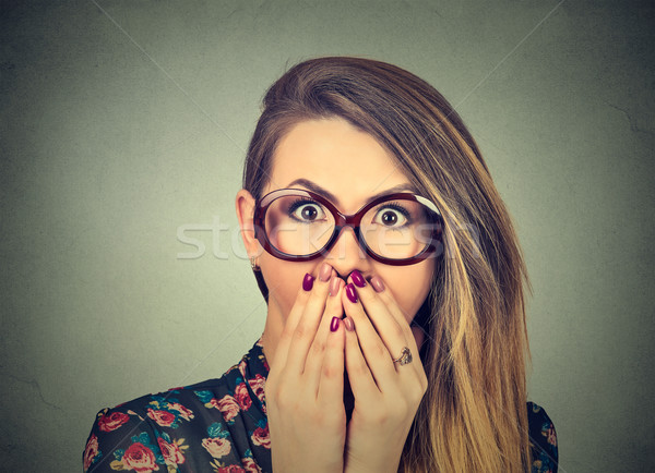 Concerned scared woman in glasses  Stock photo © ichiosea
