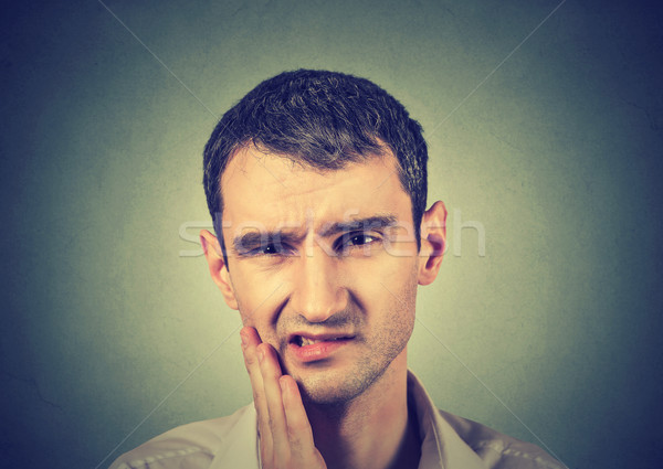 young man with a toothache tooth pain Stock photo © ichiosea