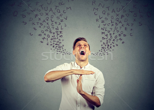 man showing time out screaming letters coming out of mouth  Stock photo © ichiosea