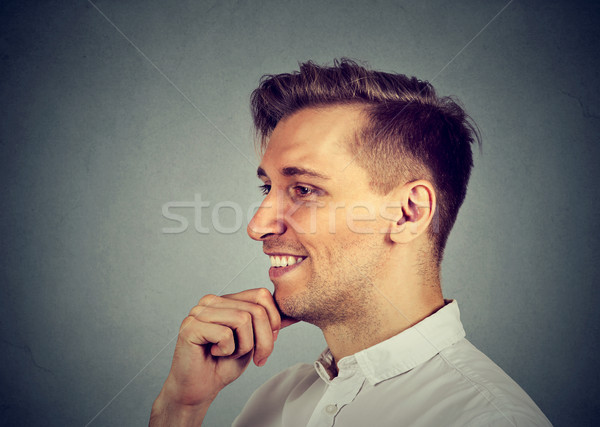 Side view of handsome happy man daydreaming  Stock photo © ichiosea