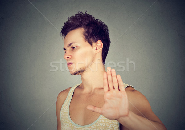 annoyed angry man with bad attitude giving talk to hand gesture  Stock photo © ichiosea