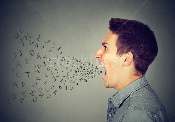 angry man screaming with alphabet letters flying out of open mouth  Stock photo © ichiosea