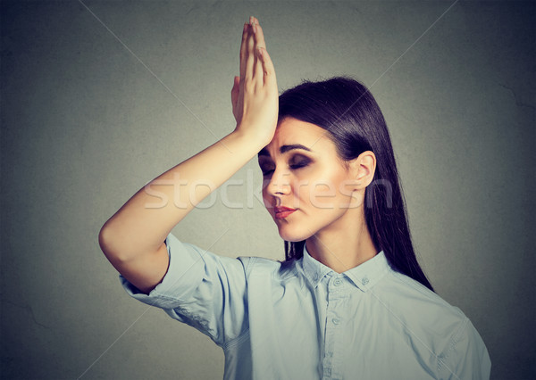 Wrong doing. Closeup portrait upset woman, slapping hand on head having duh moment  Stock photo © ichiosea