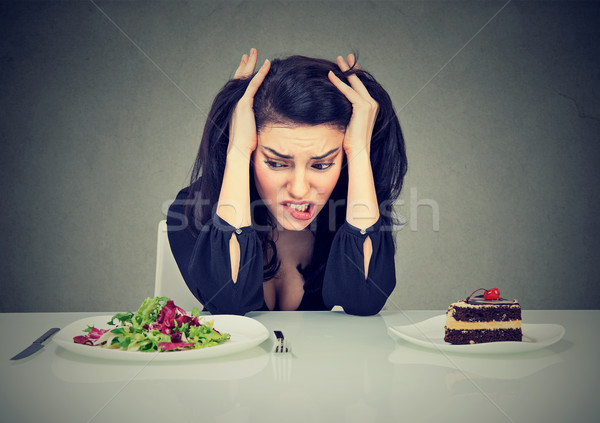 Suffering girl choosing between cake and salad Stock photo © ichiosea
