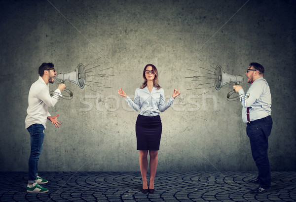meditating business woman paying no attention to angry men screaming at her in megaphone Stock photo © ichiosea