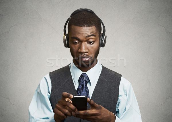Corporate executive with headphones  holding mobile phone  Stock photo © ichiosea