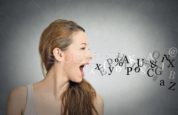 woman talking with alphabet letters coming out of mouth Stock photo © ichiosea