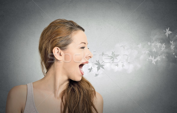 girl with leaves flying from her open mouth Stock photo © ichiosea