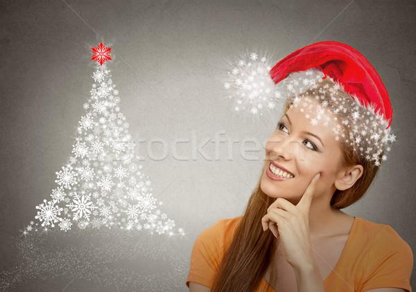Kobieta czerwony Święty mikołaj pomocnik hat patrząc Zdjęcia stock © ichiosea