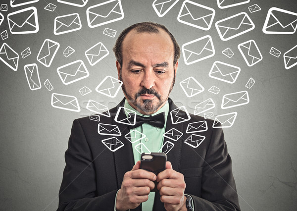 Stock photo: man sending message email from smartphone