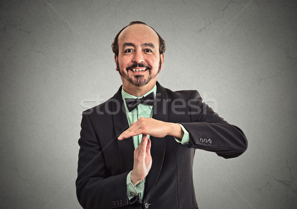 Businessman showing time out sign hand gesture Stock photo © ichiosea