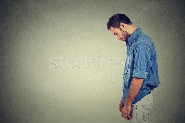 sad lonely young man looking down has no energy motivation in life depressed Stock photo © ichiosea