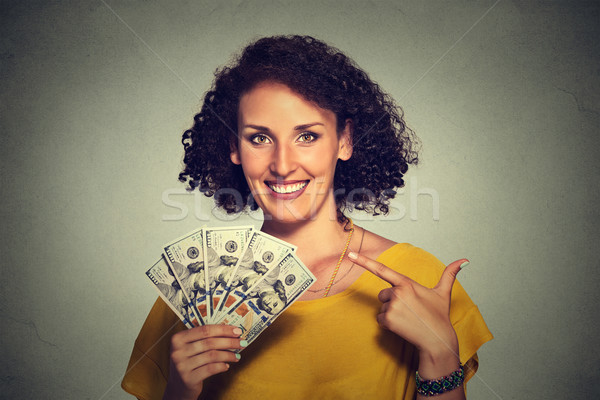 happy excited successful young business woman holding money dollar bills in hand Stock photo © ichiosea