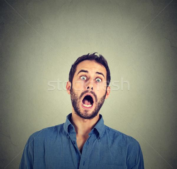 Megrémült ijedt férfi pénz szemek háttér Stock fotó © ichiosea