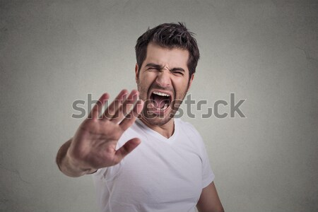 man committing suicide with finger gun gesture Stock photo © ichiosea