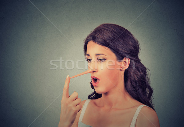 Stock photo: Woman with long nose. Liar concept. Human face expressions, emotions, feelings.