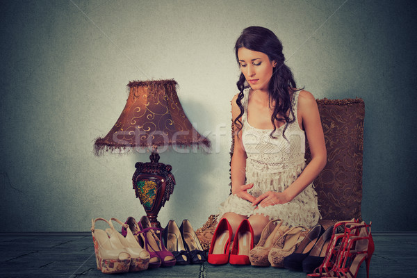 Woman making decisions picking up the right pair of high heel shoes Stock photo © ichiosea