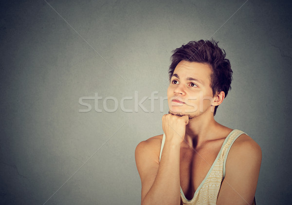 Preoccupied thinking young man looking up Stock photo © ichiosea