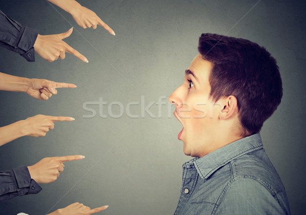 shocked man looking at many fingers pointing at him Stock photo © ichiosea