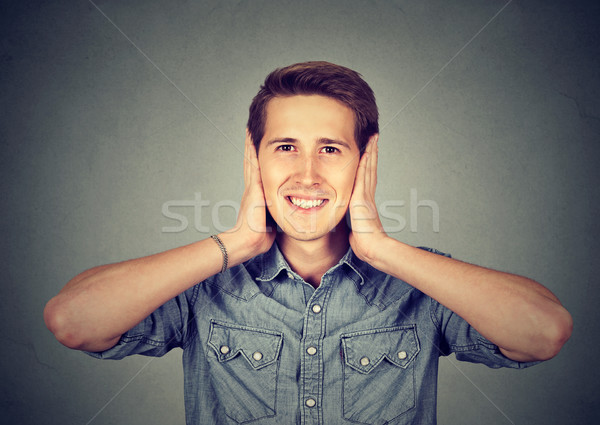 man covering his ears with hands. Hear no evil concept Stock photo © ichiosea