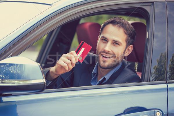 счастливым улыбаясь человека сидят внутри Новый автомобиль Сток-фото © ichiosea