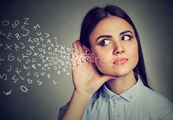 Kadın el kulak dikkatlice alfabe harfler Stok fotoğraf © ichiosea